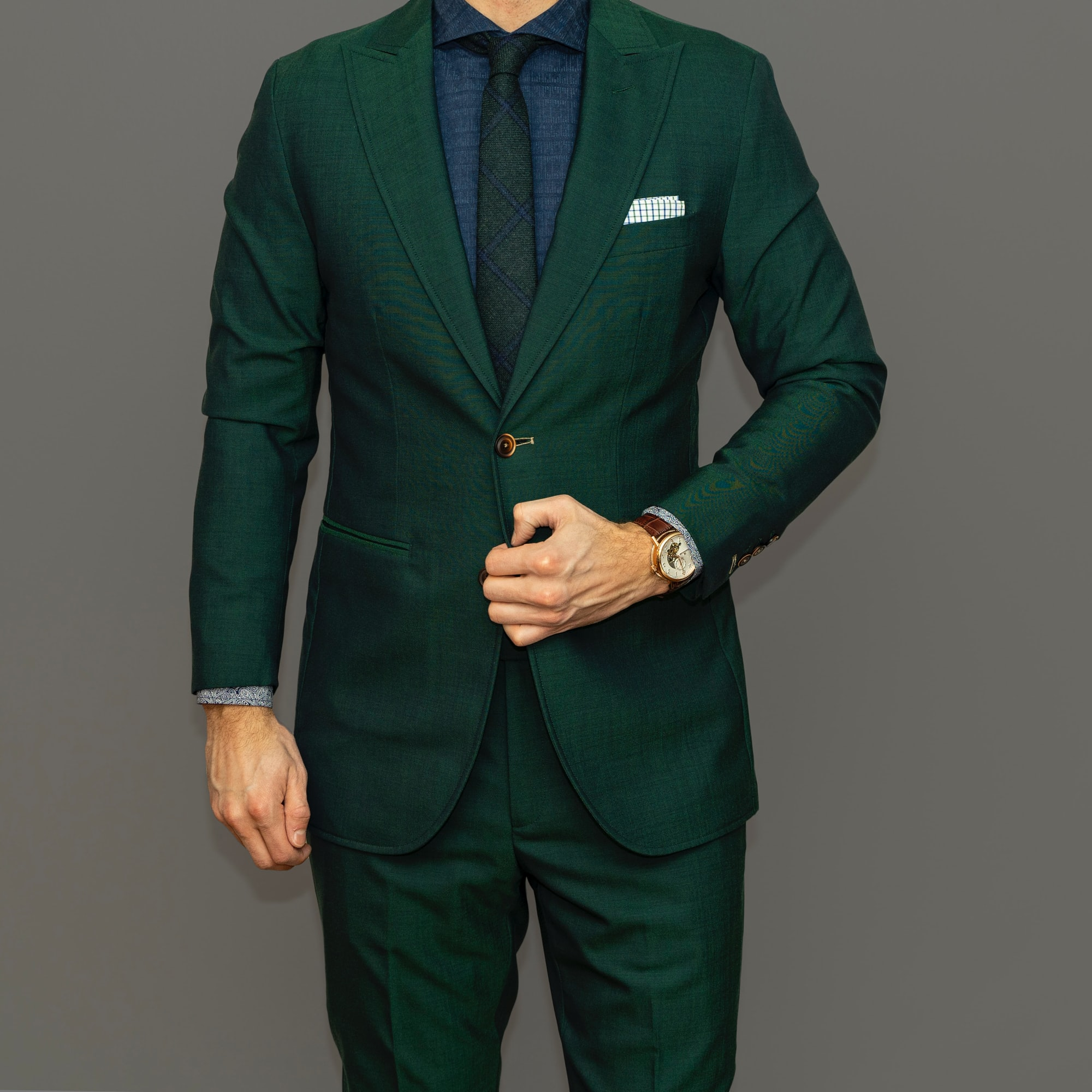 Dapper Professional showcasing one of his boldest, most modern combinations. The combination really highlights the color green, a custom green suit a custom blue shirt and a premium green tie. It might be over the top for some, but for others this is sartorial perfection.