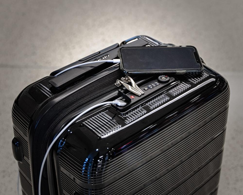 black and gray luggage bag