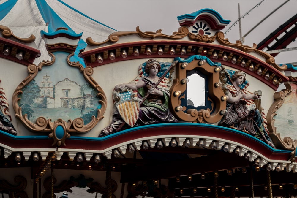 red and blue carousel under blue sky during daytime