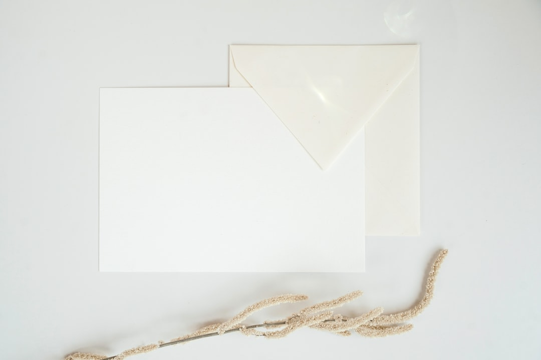 White paper with envelope.Sun Flare.