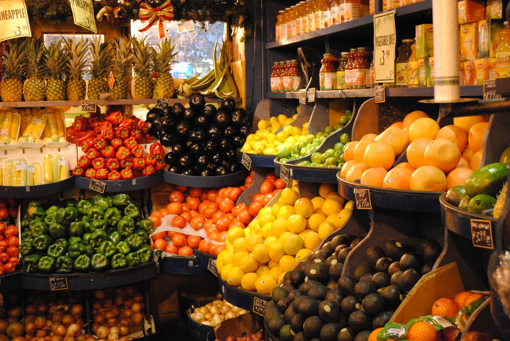 orange fruit on black fruit stand