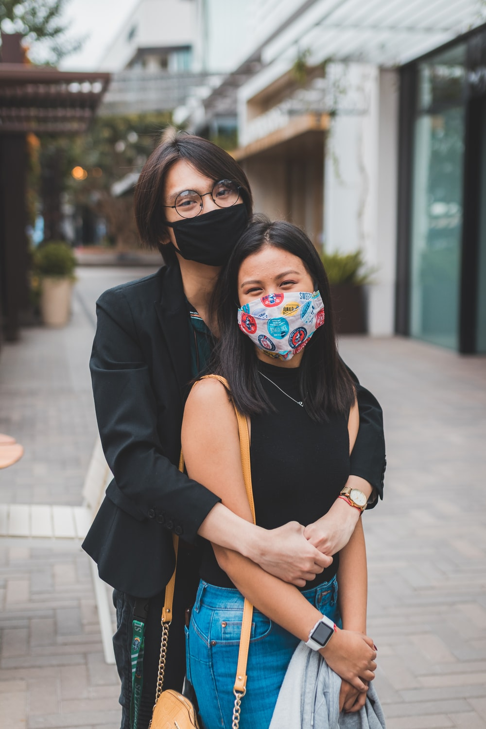 woman in black blazer with mask