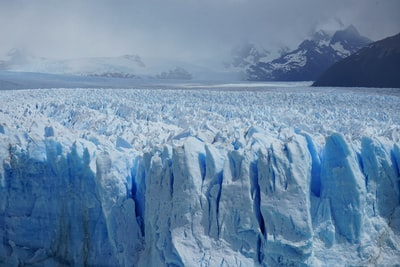 ice formation under gray sky patagonia zoom background