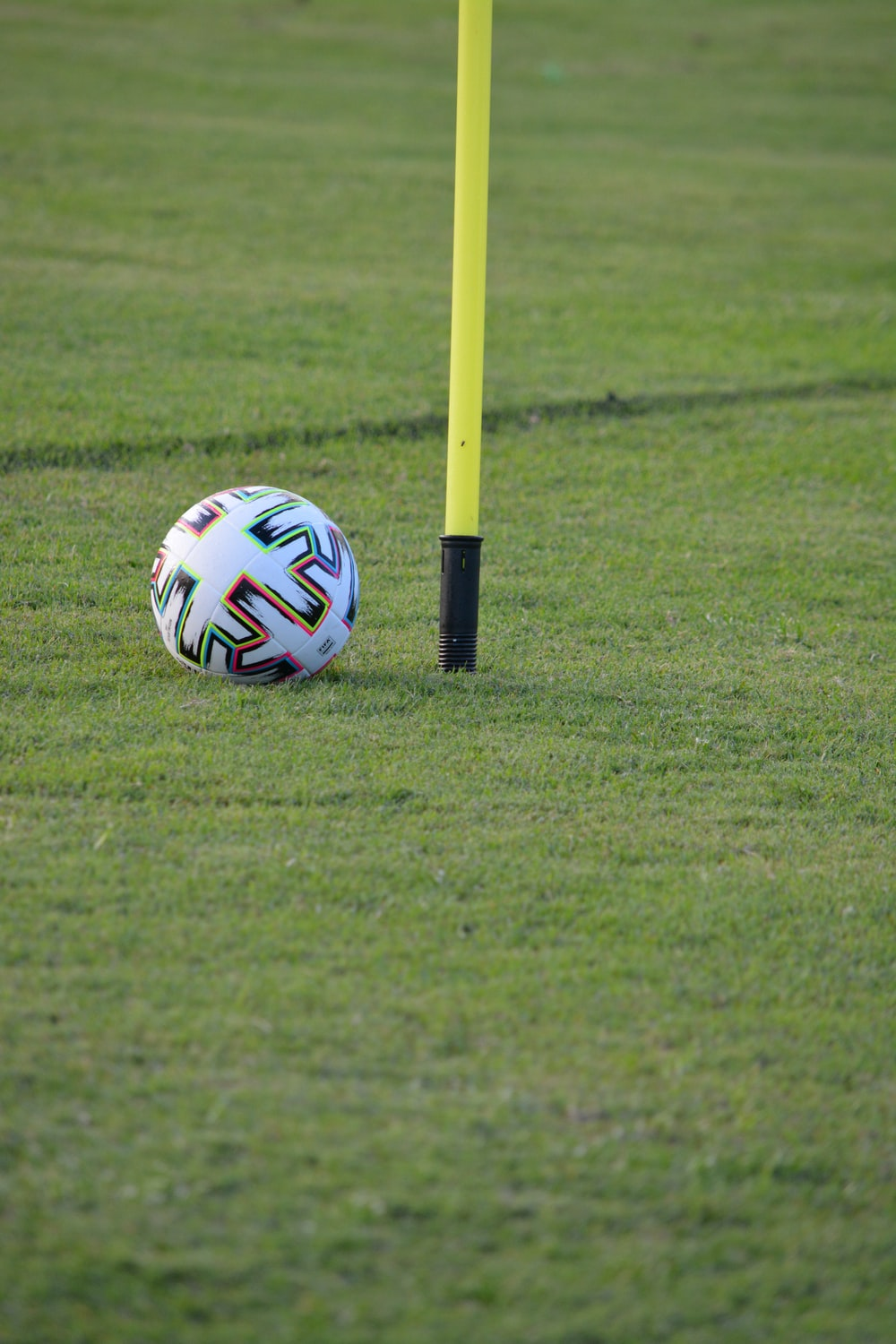 white blue and red soccer ball on green grass field