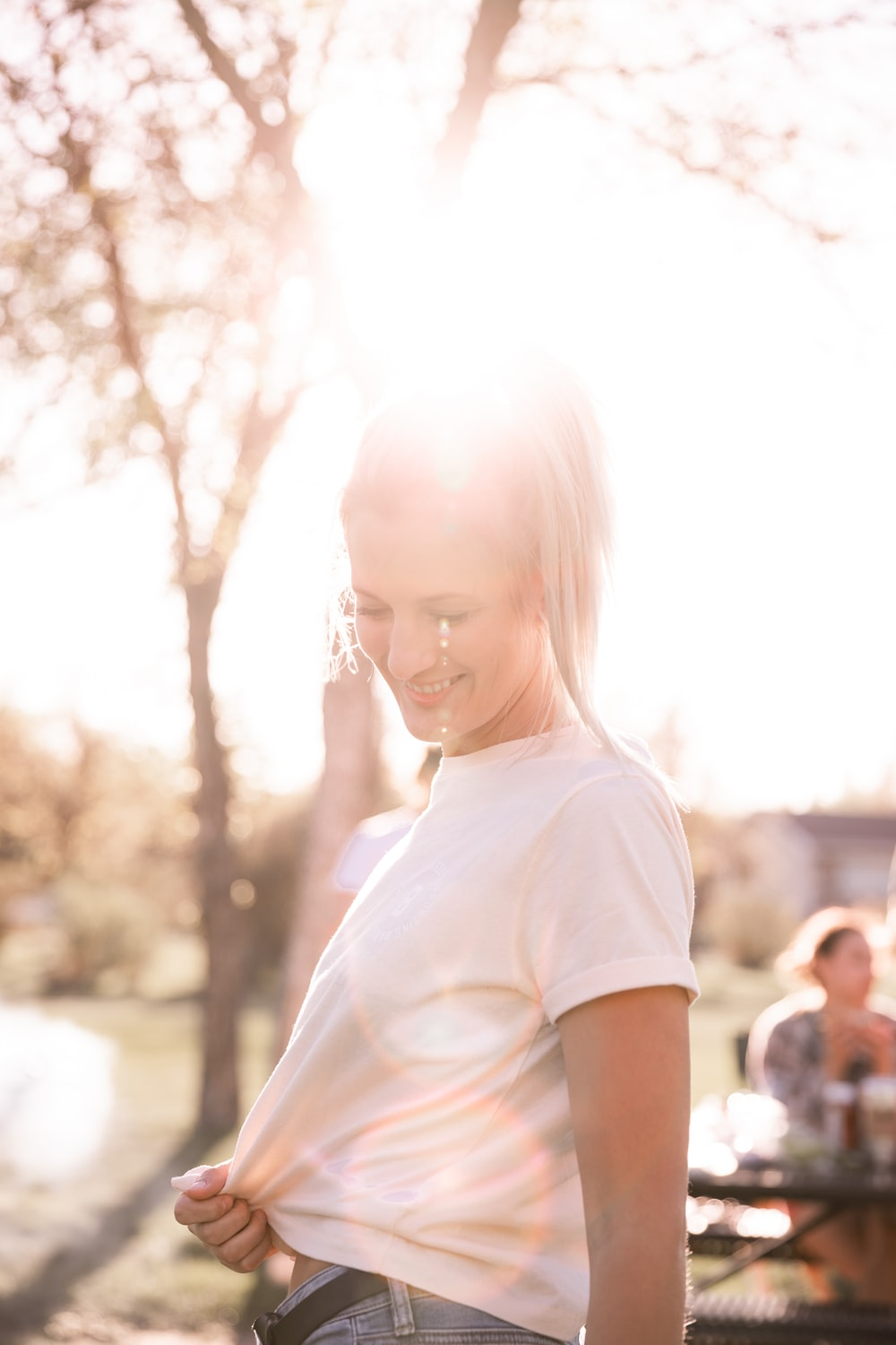 girl in white crew neck t-shirt standing during daytime