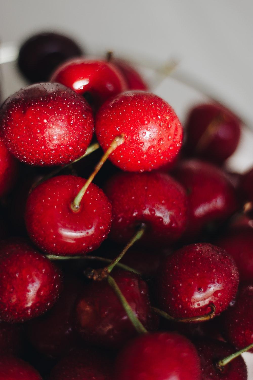 red cherry fruit in white ceramic bowl