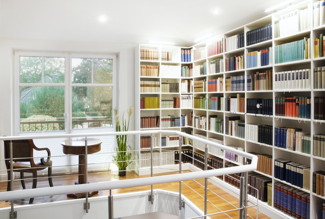 Luxurious library that runs across the corner.