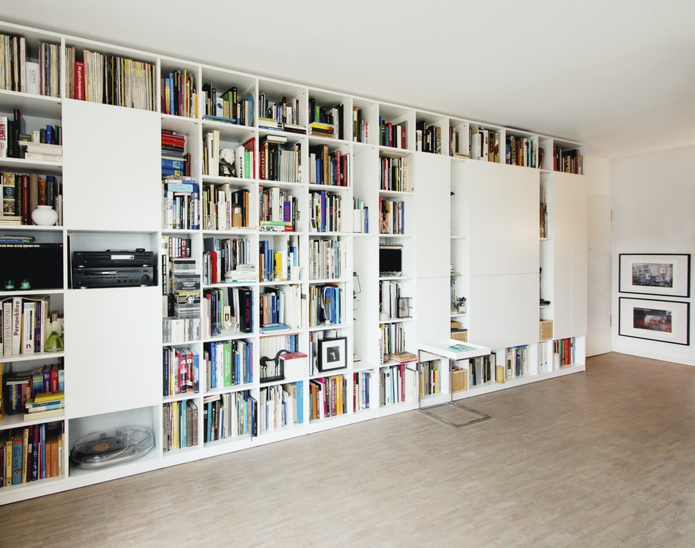 white wooden book shelf with books