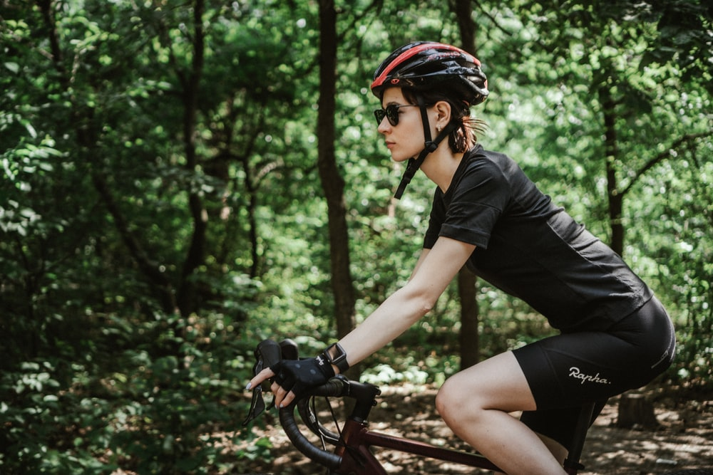 woman in black shirt riding on black bicycle