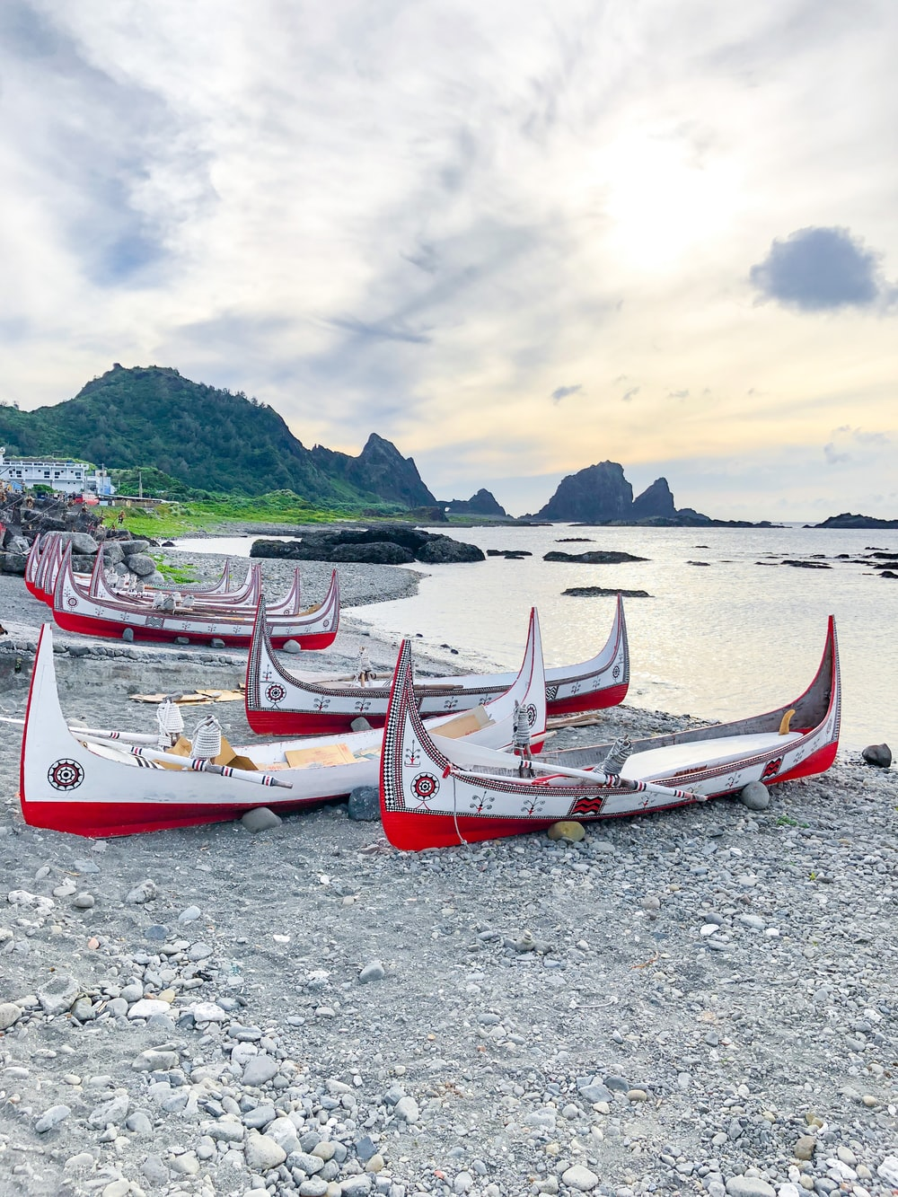 white and red boat on beach during daytime