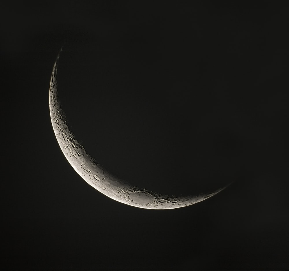 white crescent moon in black background