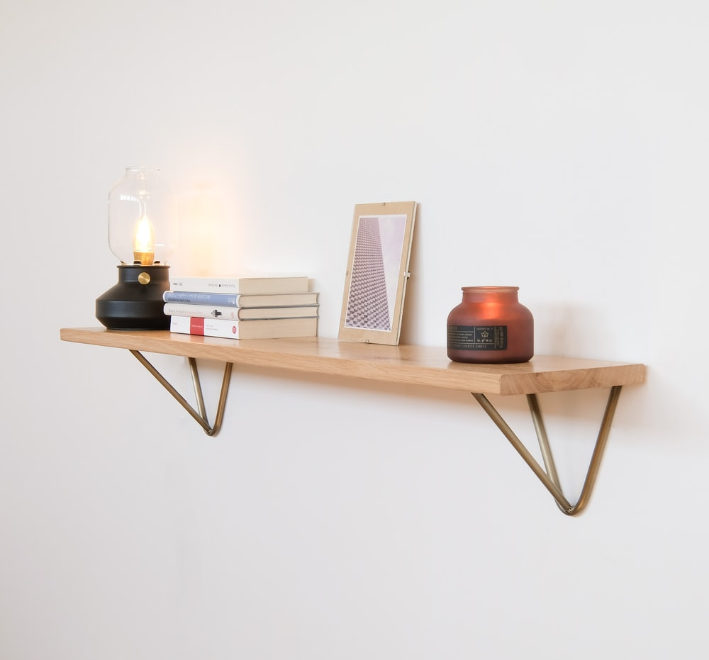 brown wooden table with black ceramic mug and candle holder