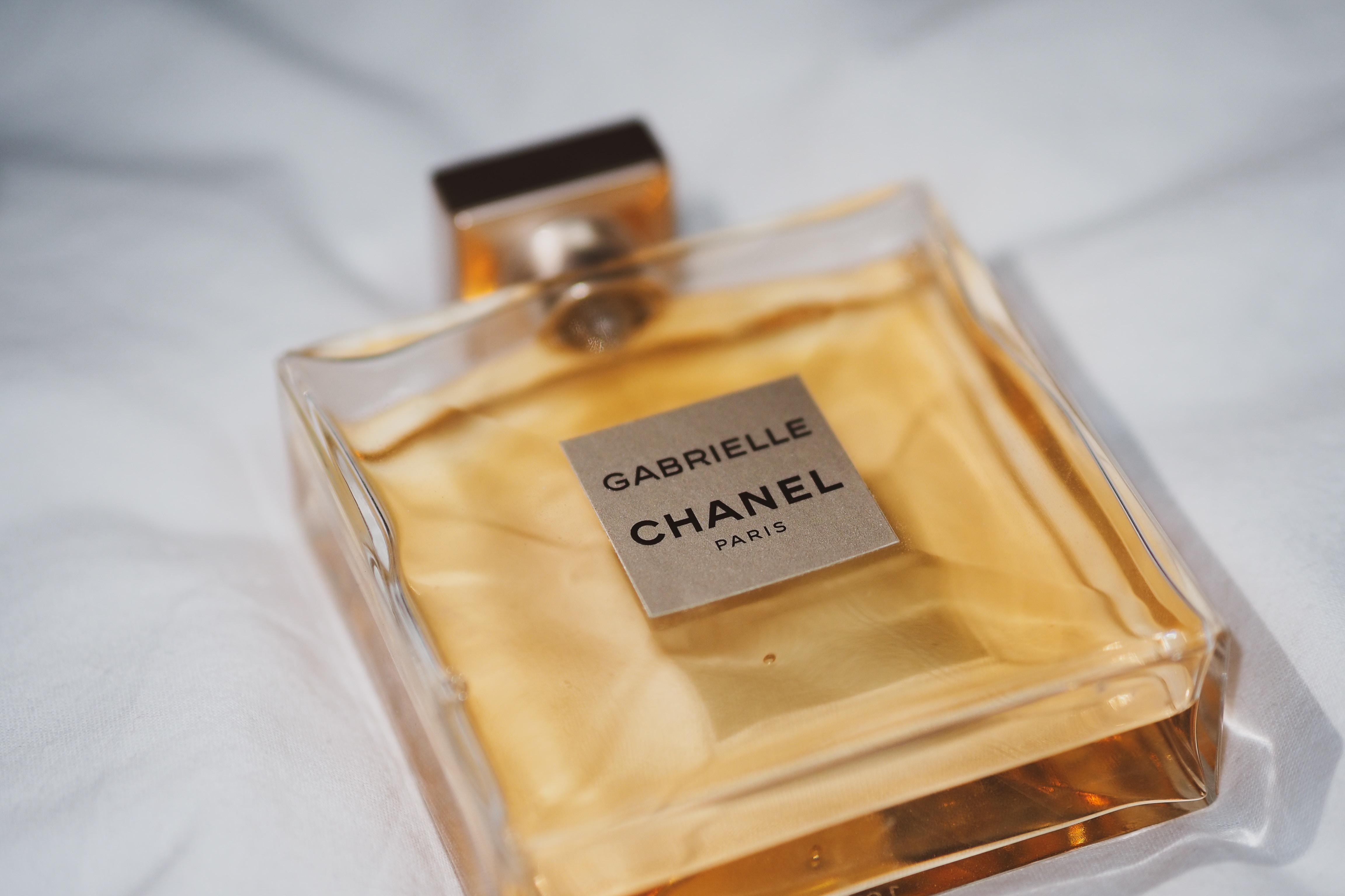 love you perfume bottle on white textile