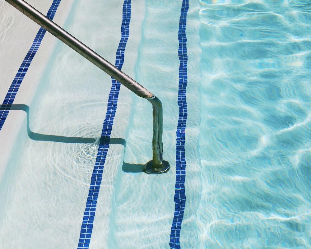 black strap on blue swimming pool