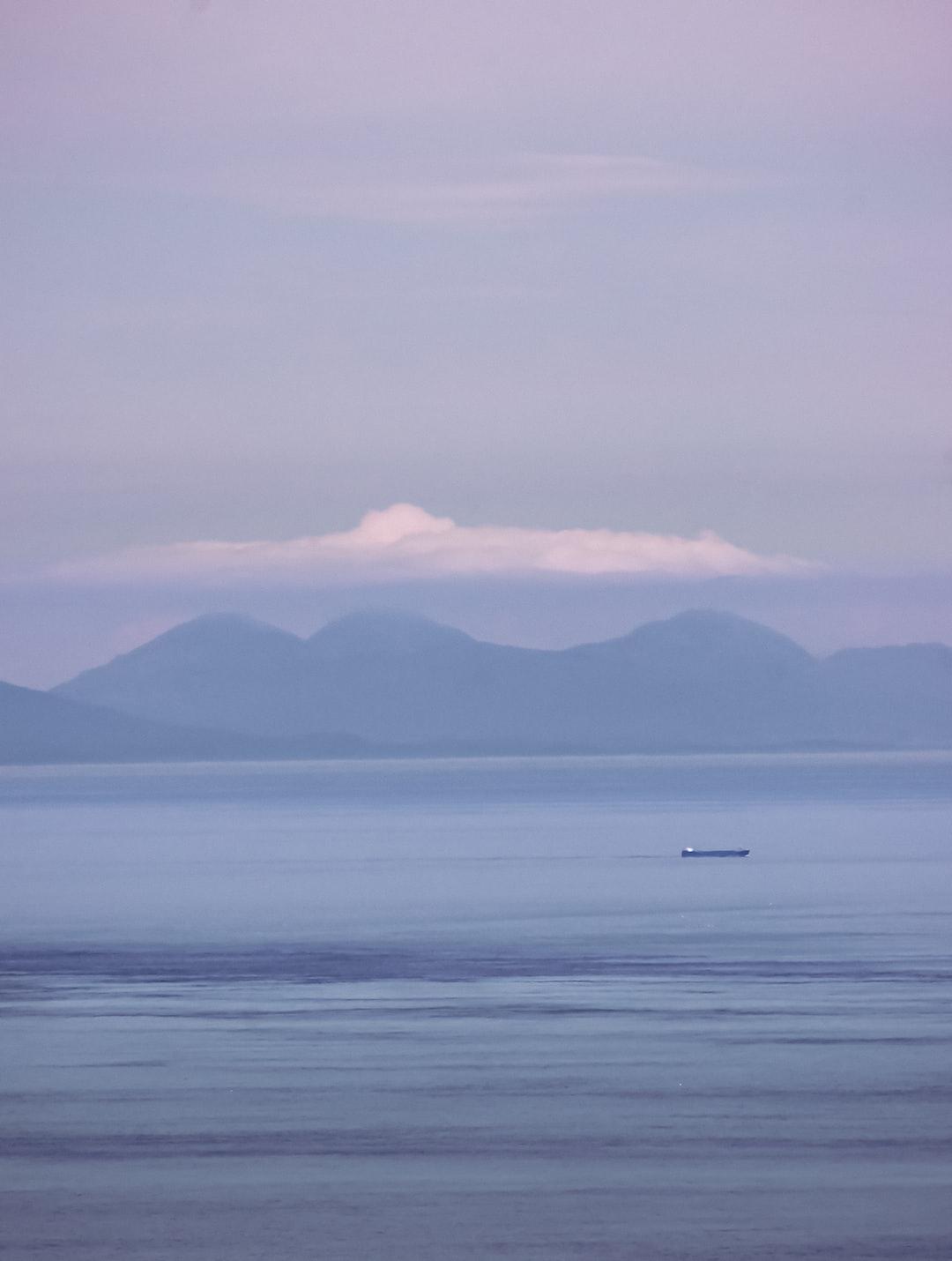 A tanker sails toward the Irish Sea past the coastline of the Scottish Highlands (shot from Fair Head, Jun., 2020).