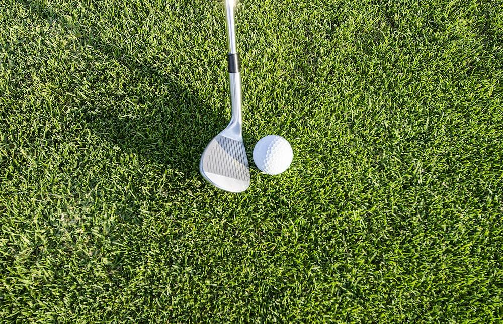 white golf club on green grass field