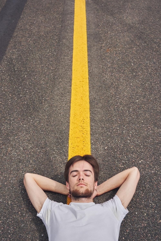 girl lying on the road