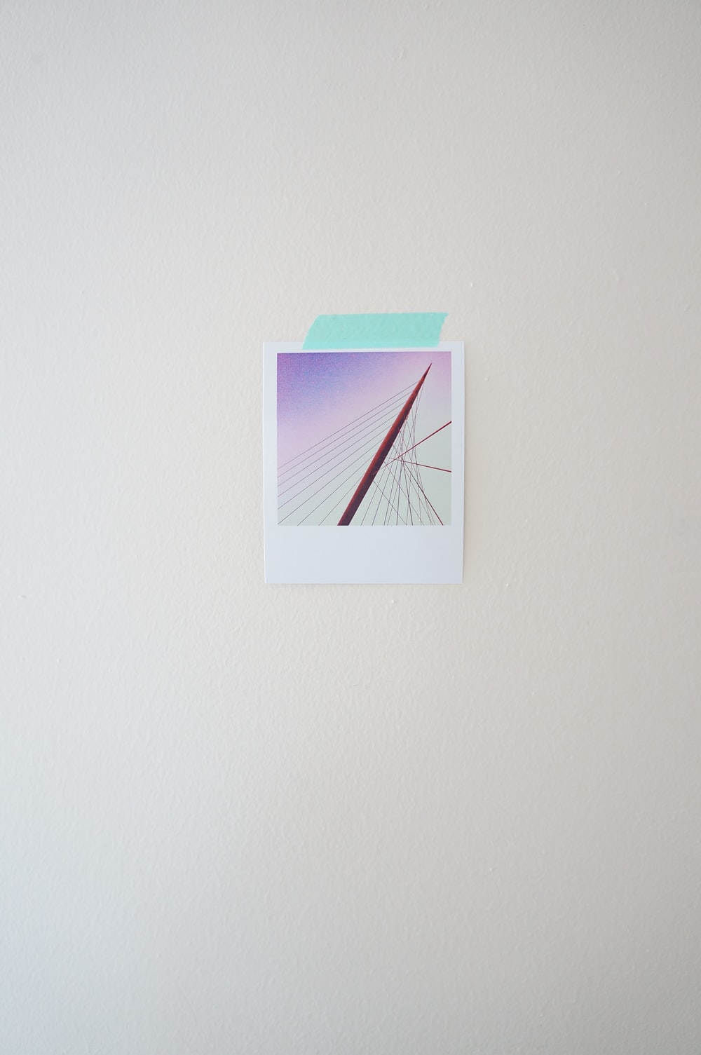 pink and white wall clock at 7 00