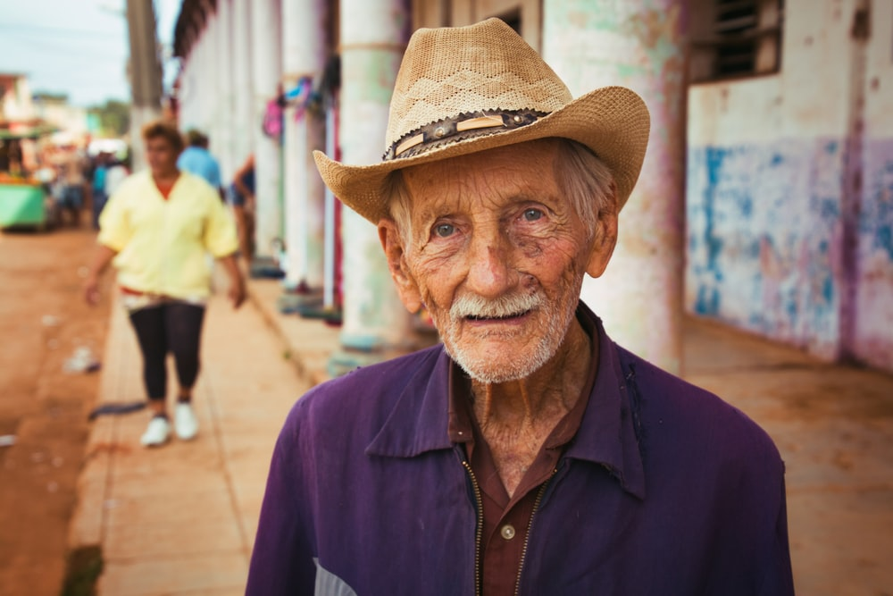 man in blue button up shirt wearing brown cowboy hat
