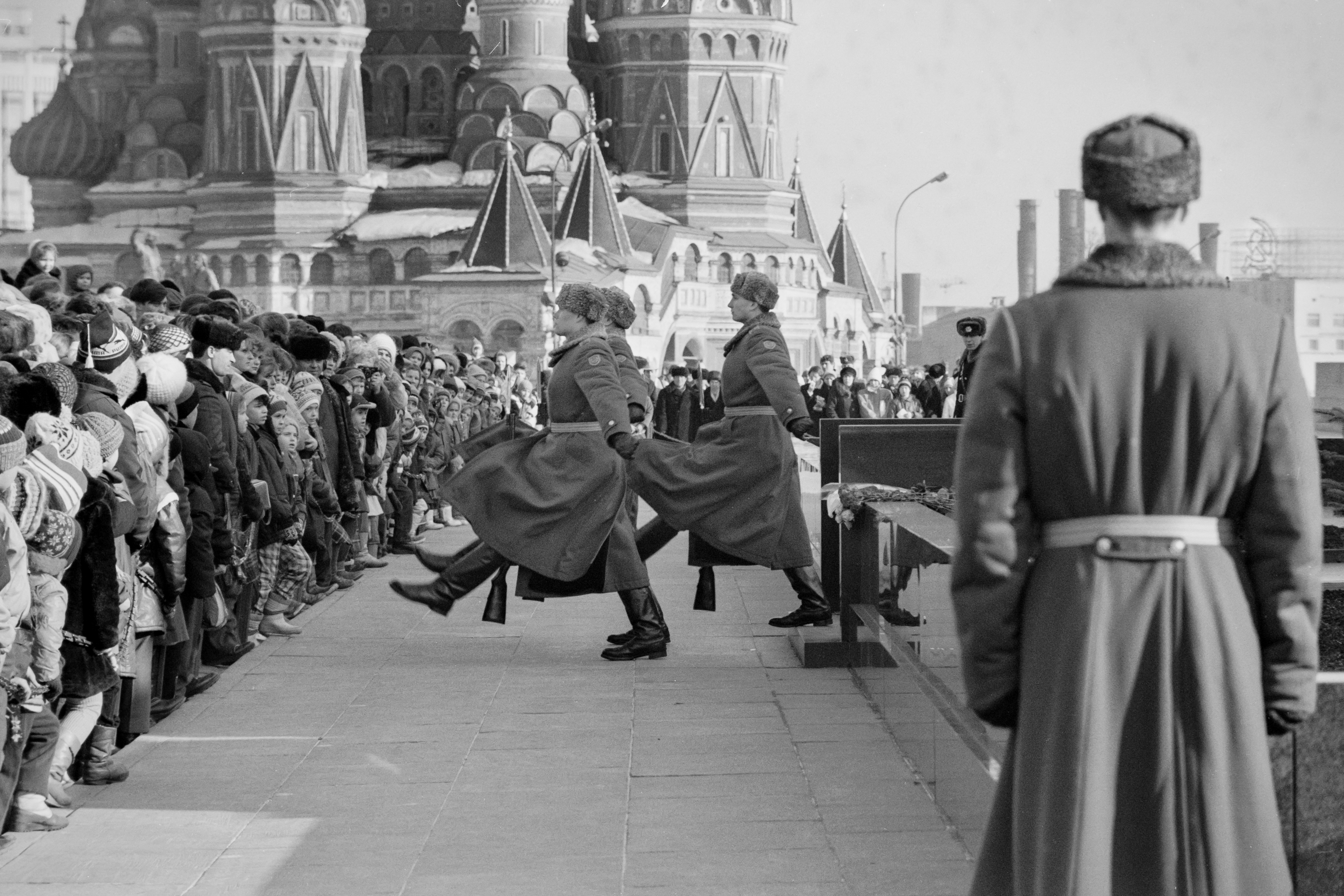 A crowd watches the hourly changing of the honor guard at Lenin's mausoleum in Red Square, Moscow, c.1986. President Boris Yeltsin ended the honor guard in 1993.