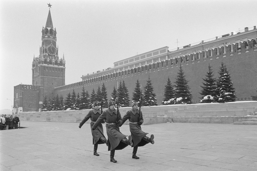 Just before 12 noon, according to the clock on the Kremlin's Spassky Tower, a crowd watches the changing of the honor guard at Lenin's mausoleum in Red Square, Moscow, c.1985. President Boris Yeltsin removed the honor guard in Oct. 1993.