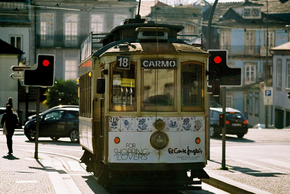 white and yellow tram on road during daytime