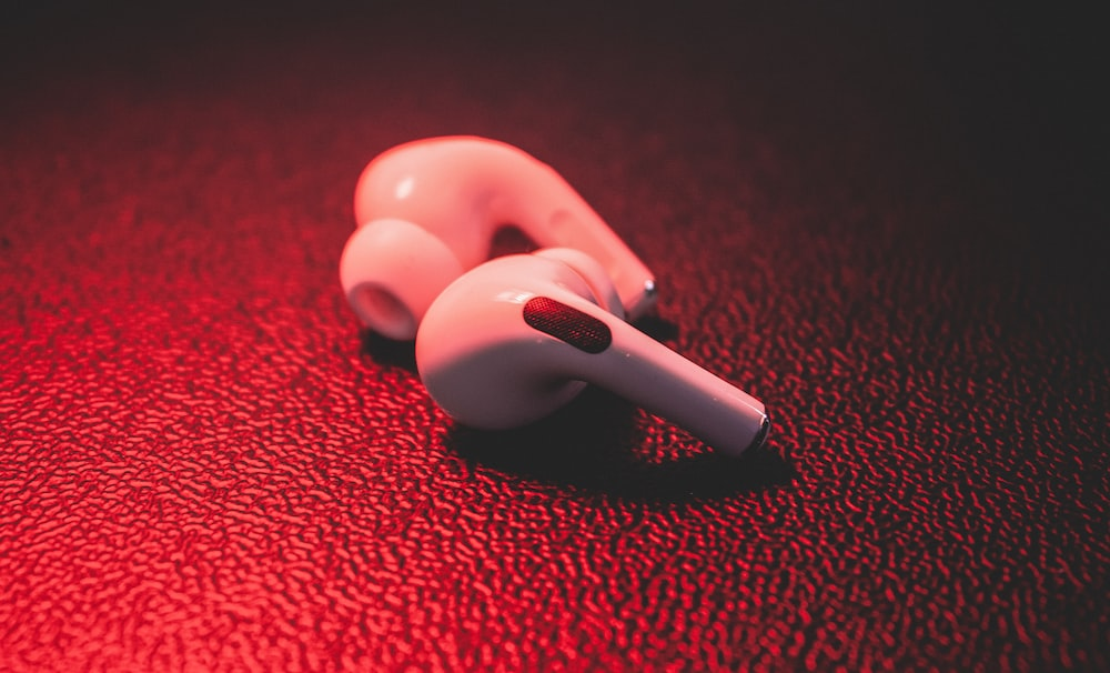 red plastic toy on red textile