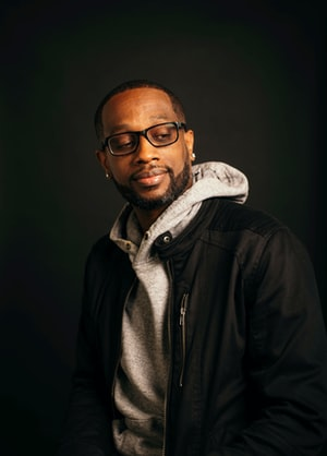 Man in a hoodie and glasses