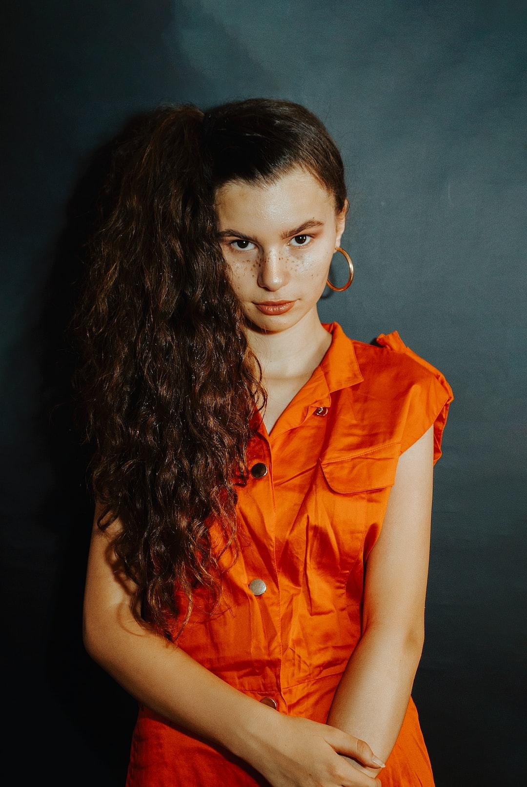 Fine Art Backdrop portrait of a sitting gorgeous young model.