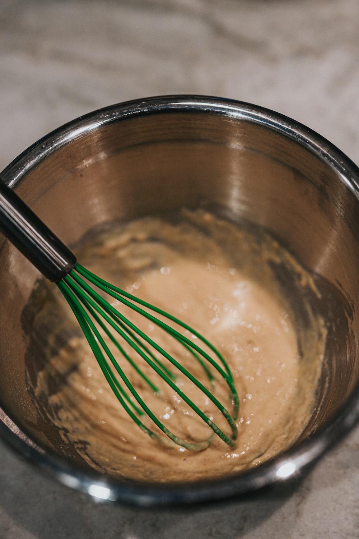 stainless steel fork on brown ceramic bowl