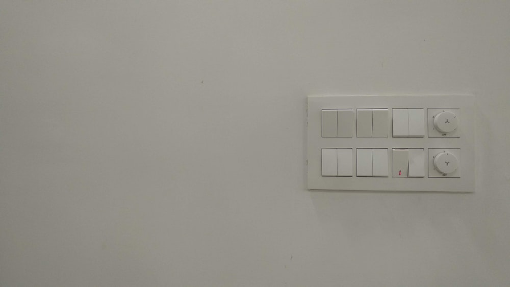 white wall mounted device on white painted wall
