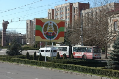 Tiraspol red and white bus on road during daytime