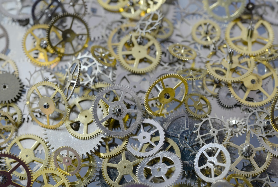Macro of metal gears, cogs and wheels from old watches.