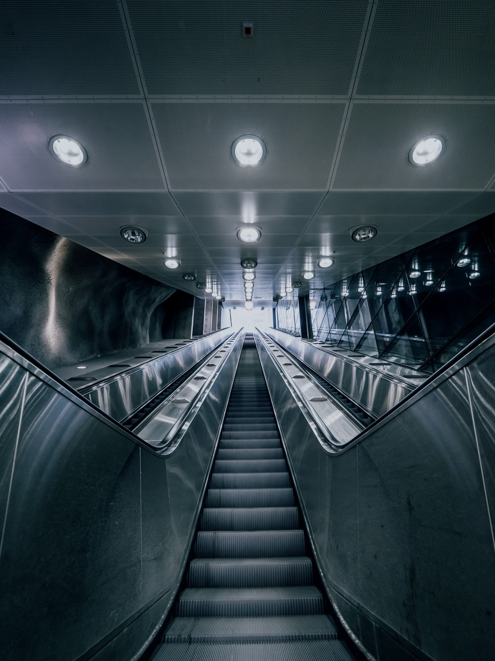 gray and black escalator in a building