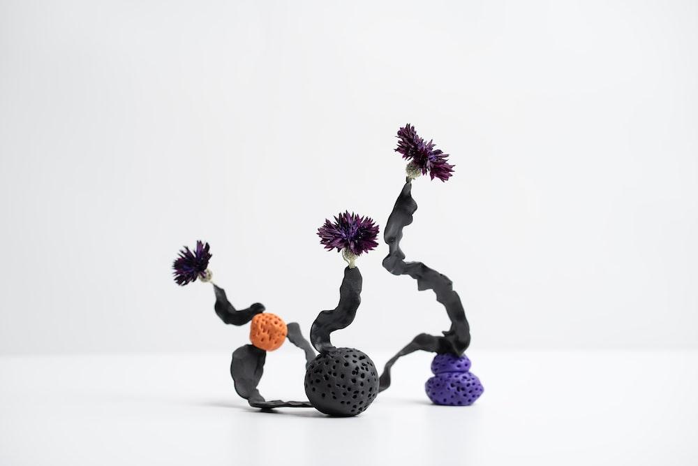 purple and orange flowers on white table