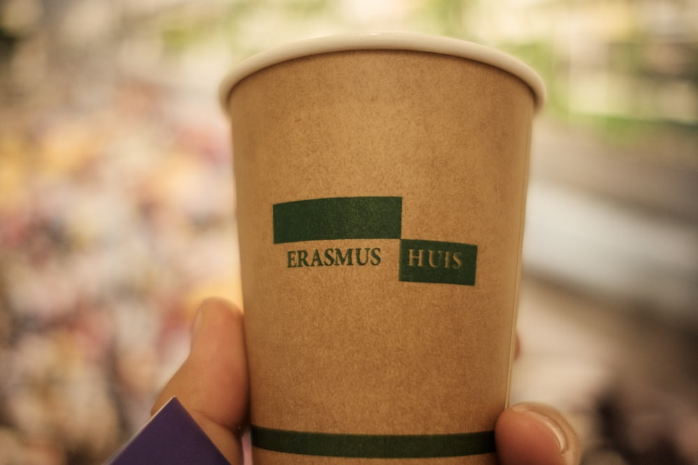 brown and green paper cup
