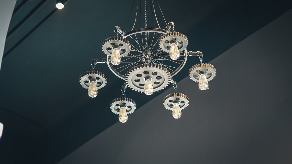gold and white chandelier turned on during daytime