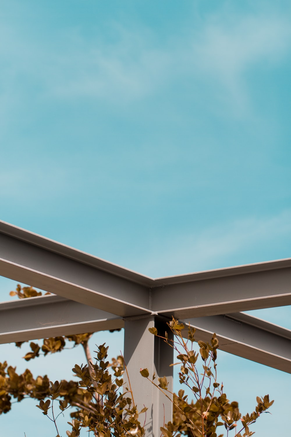 brown and white wooden roof under blue sky during daytime