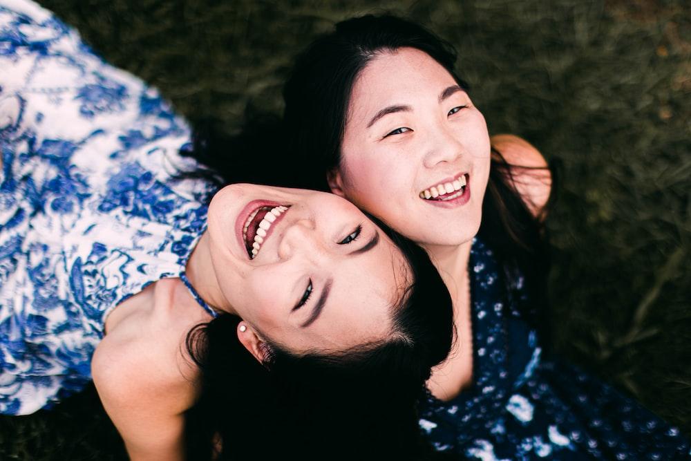 2 women lying on ground