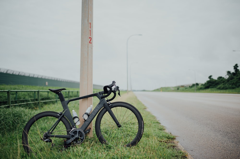 black and gray bicycle on gray asphalt road during daytime