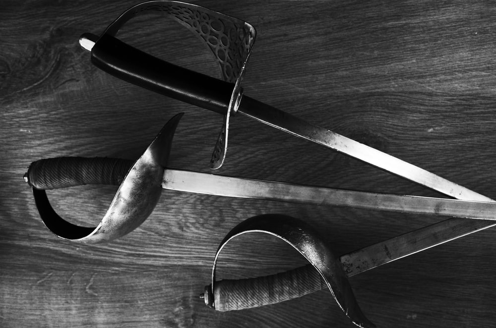 black and silver scissors on wooden table