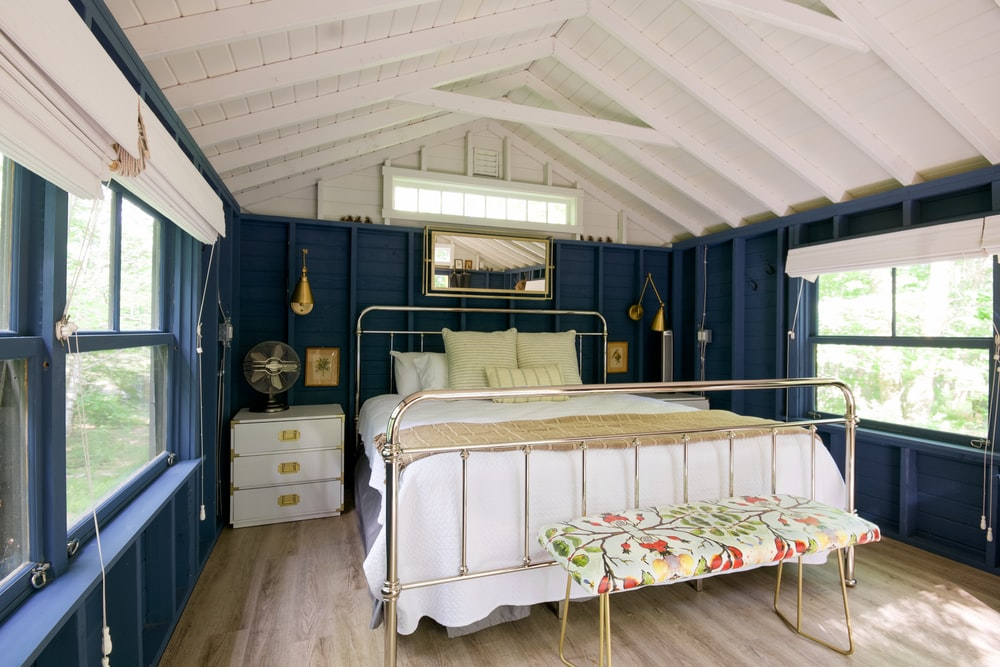 white bed near white wooden cabinet