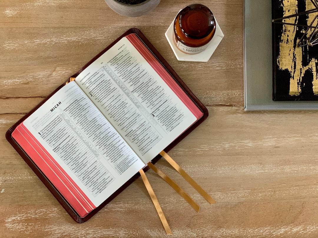An Allan NIV Bible sits open atop a copy table.