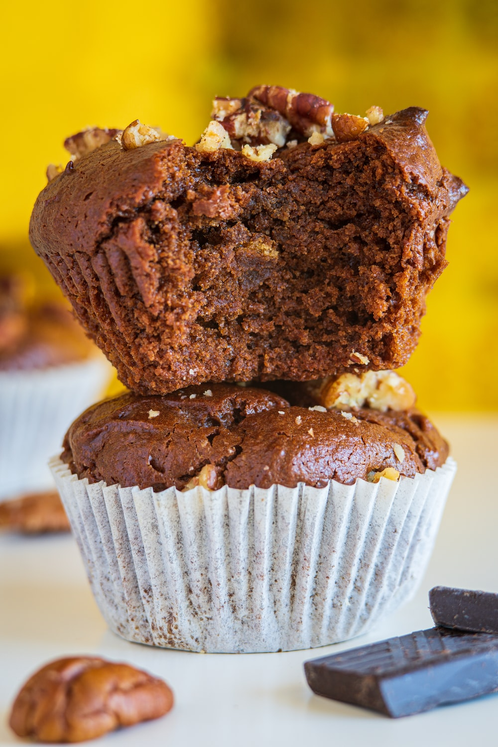 chocolate cupcake on white paper plate