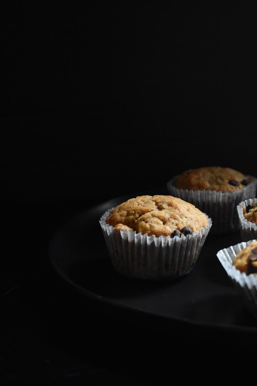 brown cupcake on white paper