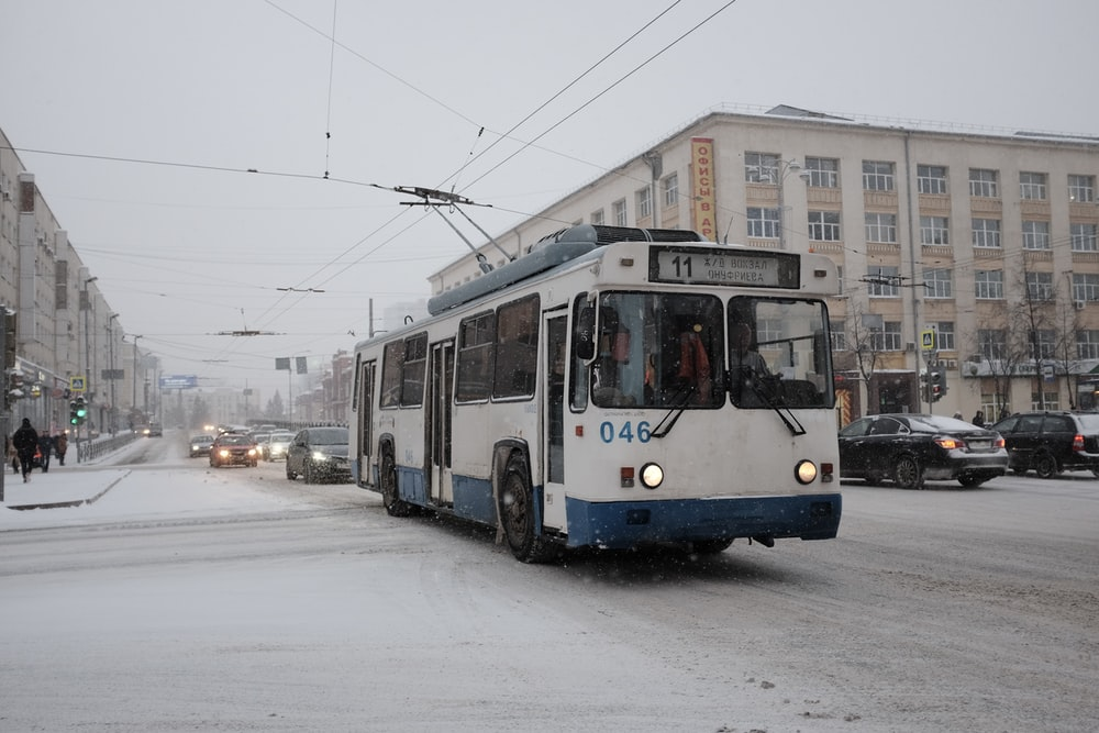 blue and white tram on road during daytime