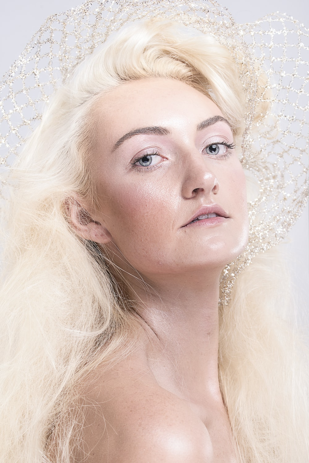 woman with blonde hair and white pearl earrings