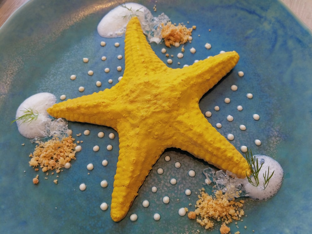 yellow star fish on blue and white polka dot textile