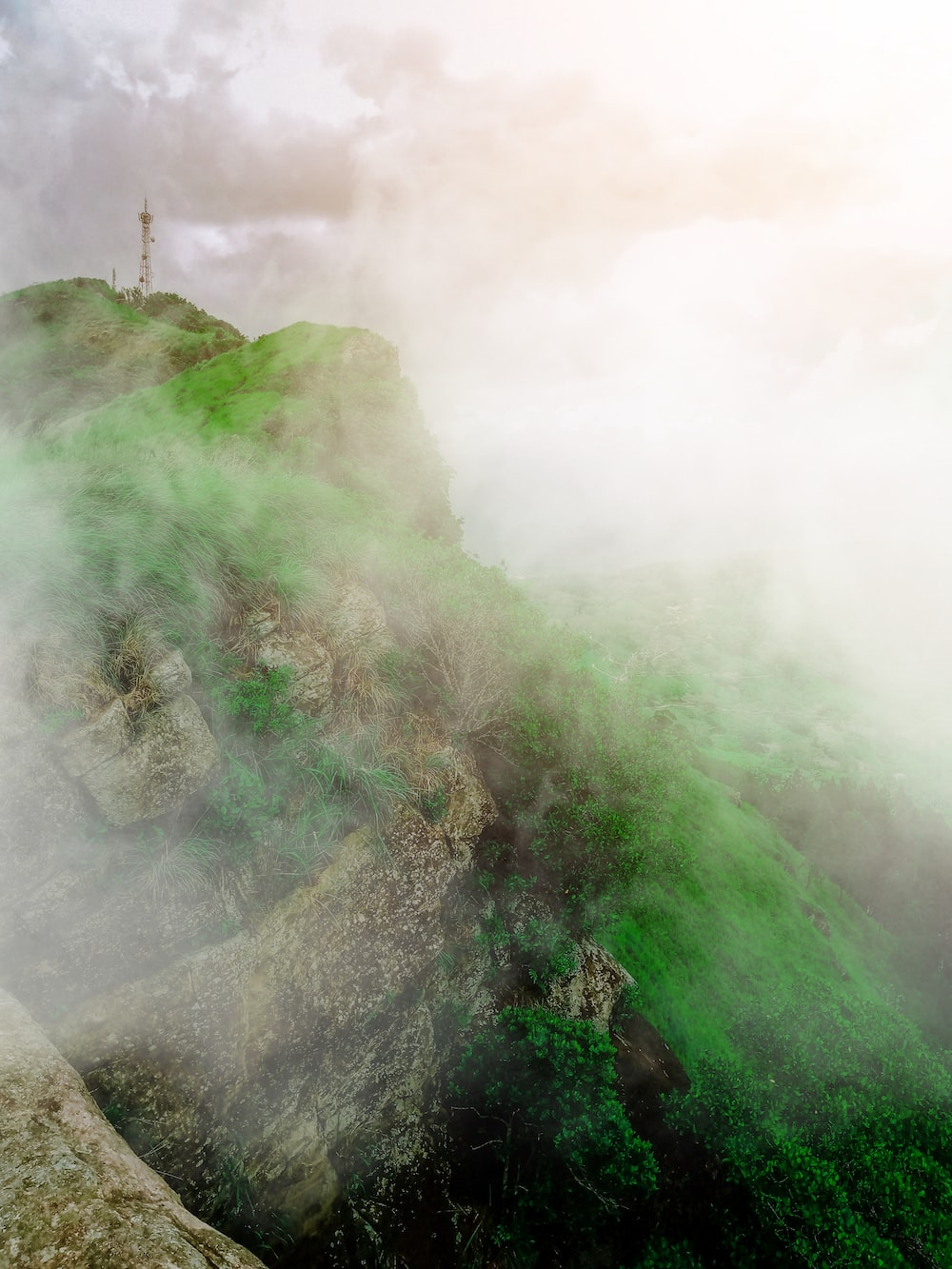 green mountain covered with fog