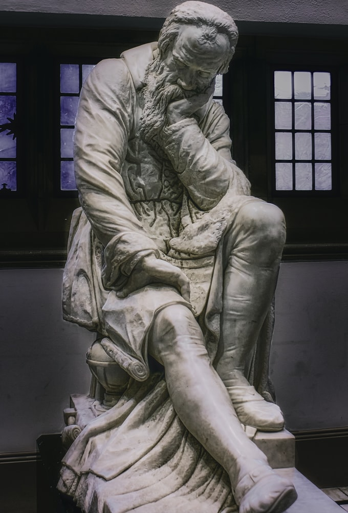 Marble sculpture of Galileo Galilei contemplating the nature of the universe